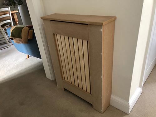 Purpose made radiator cover